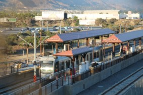The Irwindale Station and a test train with the 210 in the background.