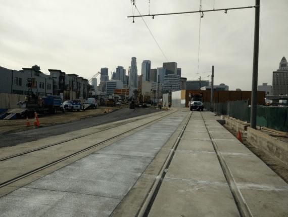 The pedestrian walkway and roadway widening work on 1st Street.