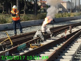 Rail welding taking place on at-grade section adjacent to Florence Avenue.