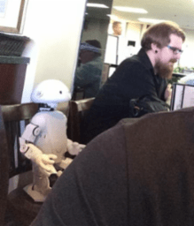 This robot brought his nerd to the cafe.