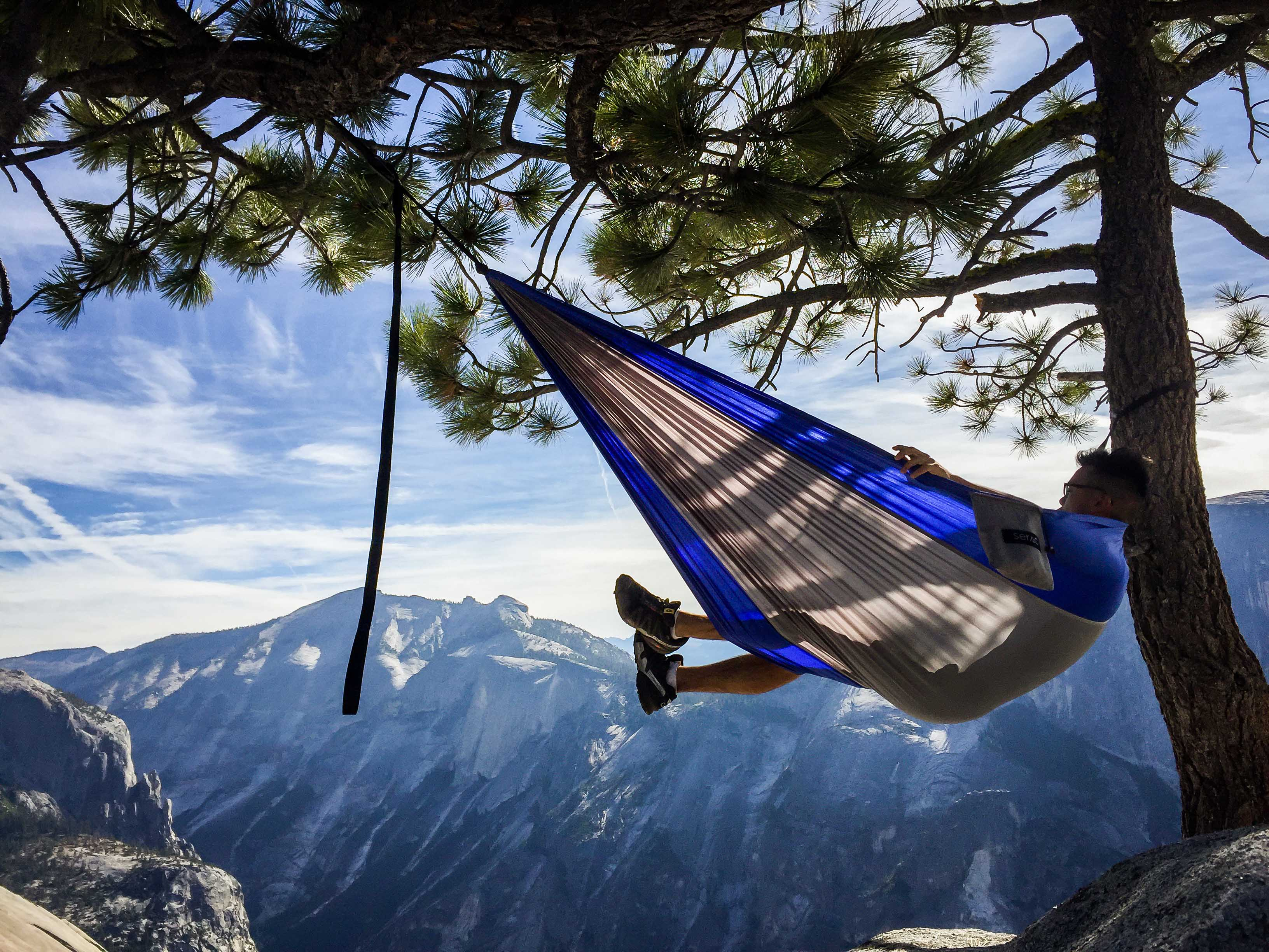 Hanging in a Serac Ultralight Camping hammock on North Dome, Yosemite National Park