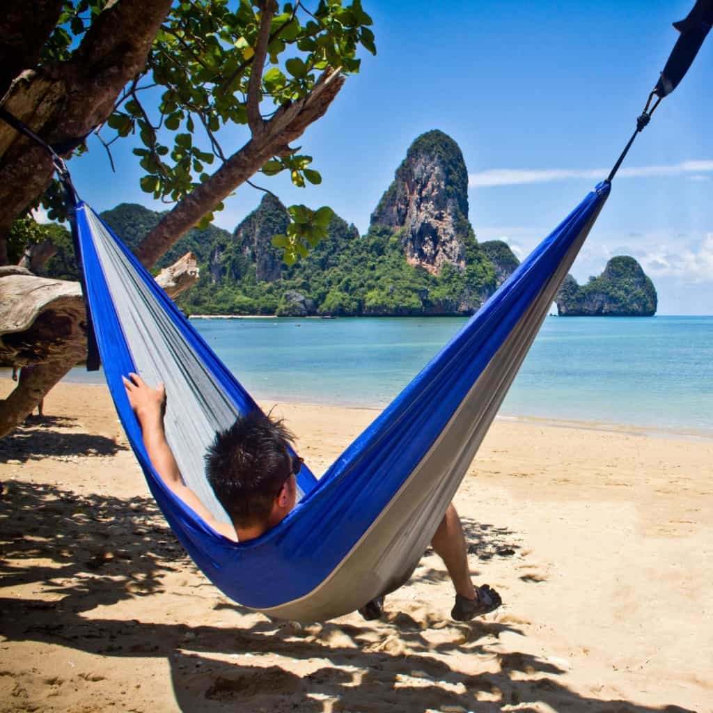 enjoying the view of a thai beach while relaxing in the best serac ultralight hammock