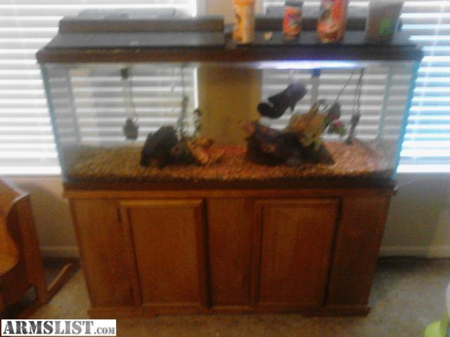 ARMSLIST   For Sale/Trade: 55 gallon aquarium and stand with fish