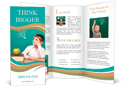 Cheerful little boy sitting at the table School concept Brochure
