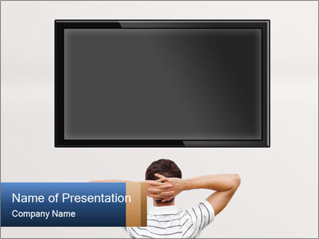 Man Sitting in Front of TV Screen PowerPoint Template  Backgrounds