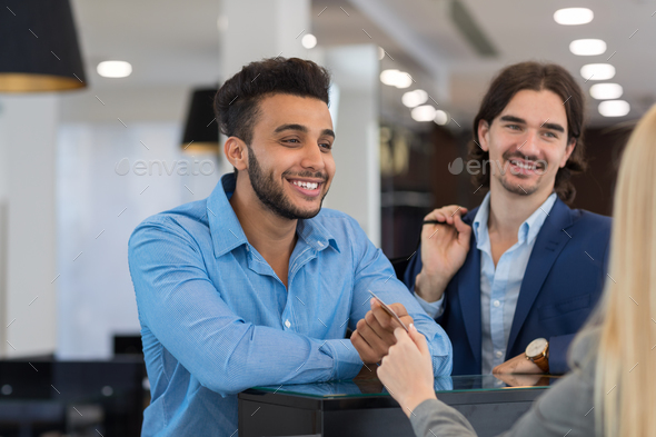 Happy Smiling Business Man Give Credit Card To Female Shop Assistant