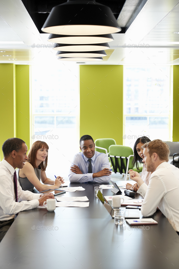 Business colleagues at an informal meeting, vertical Stock Photo by