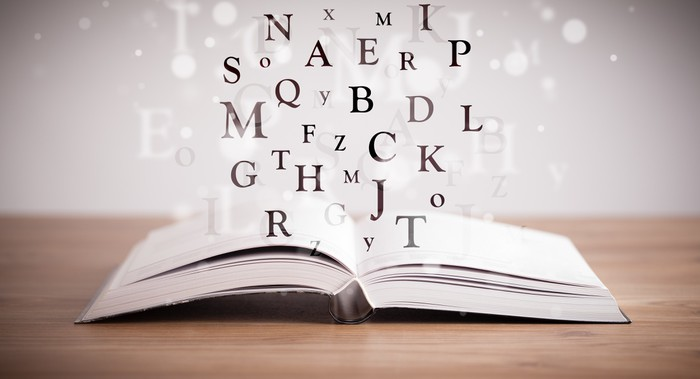 Opened book with flying letters Wall Mural \u2022 Pixers® \u2022 We live to change - opened book