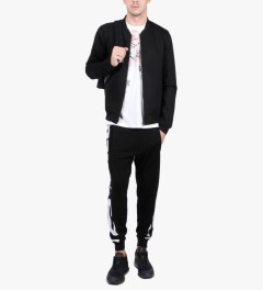 McQ by Alexander McQueen Black/White MCQ Text Stripe Print Jogger Pants Model Picutre