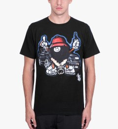 Stussy Black Phade 8 Ball Man T-Shirt Model Picutre
