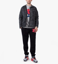 Undefeated Black/Red 5 Strike Sweatpants Model Picutre