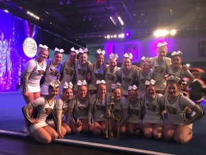 Team picture at UCA Nationals with 6th place trophy