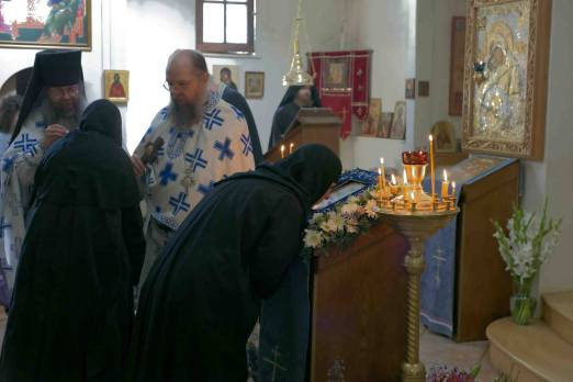 Nuns of St. Xenia Skete venerating the icon after the Liturgy.