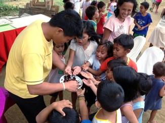 Children receiving a treat at Biliran medical camp