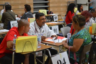 Doctor consulting with patient at Medical Camp in Corona, California