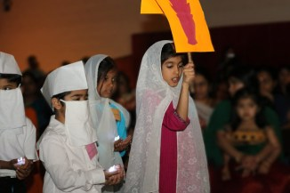 Children representing Zorastrian faith in procession