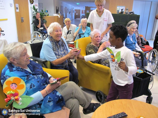 Child giving gift to a senior