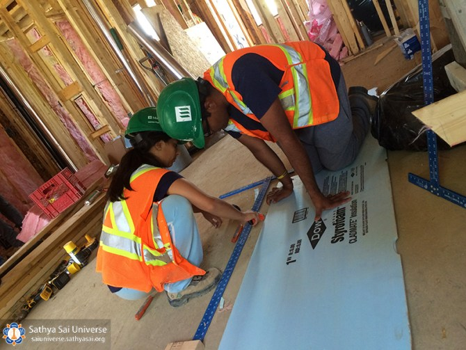 sai-youth-preparing-walls-for-installation-copy