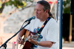 Michael Hare plays guitar