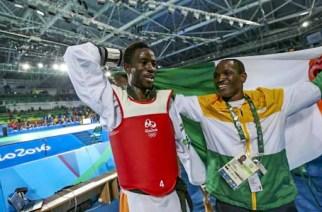L'ivoirien Cheikh Cissé, médailler d'or au taekwondo et son entraîneur