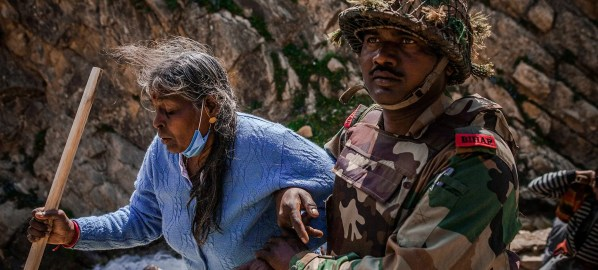 Photo: Army officer helps an Amarnath yatra pilgrim