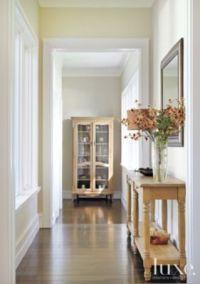 Transitional Cream Hallway with Walnut Flooring ...