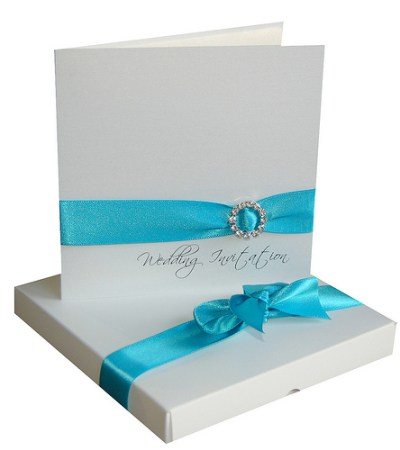 turquoise wedding invitation card with ribbon