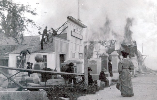 One of two known photographs taken while post-earthquake fires were underway. Taken from the marble and granite works on the corner of Fourth and Davis, looking west (Bancroft Library)