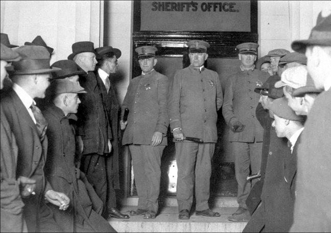 Early in the siege on the Sonoma County Jail on December 5, 1920. The Santa Rosa police officers are Obe Cockrill, Herman Hankel and G. C. Feliz. Photo: Hamilton H. Dobbin collection, California State Library.