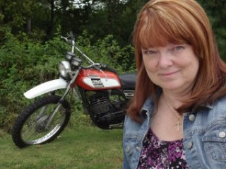 Diana, with her 1975 Yamaha Enduro, which is the same motorcycle her character, Calvin rides in Running Lean.