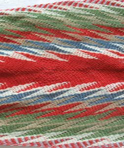 The sash belonging to Métis leader Elzéar Goulet of arrow-and-lightning pattern was very loosely woven.
