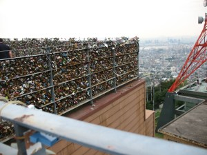 padlocks on the fence at the base of the Seoul tower