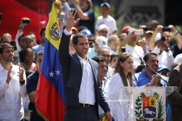 Venezuelan opposition leader and self-proclaimed interim president Juan Guaido waves to supporters during a rally against Venezuelan President Nicolas Maduro's government in Caracas, Venezuela February 2, 2019. REUTERS/Andres Martinez Casares