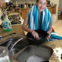 madison cleaning the kitchen