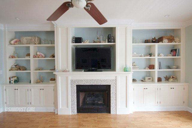 Built-in bookshelves and fireplace surround.  http://sawdustgirl.com