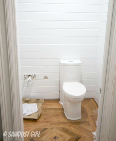 installing a one piece skirted toilet