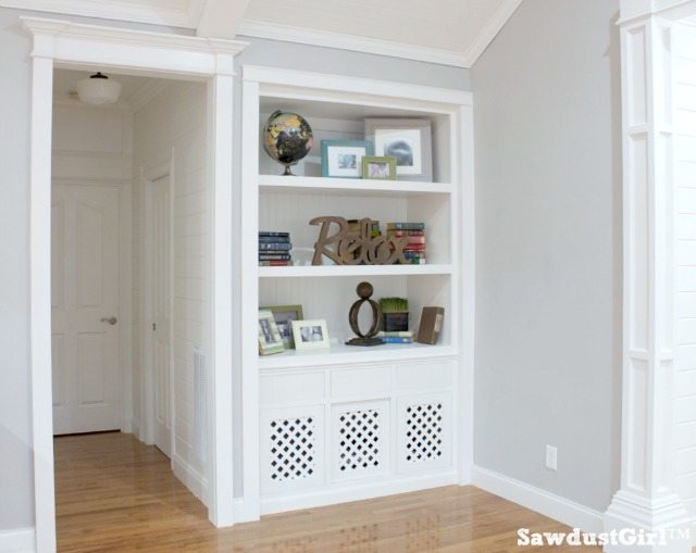 White built-ins, hallway with planked walls and trim moulding.