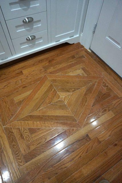 Replacing wood floor decorative insert sawdust girl for Replacing hardwood floors