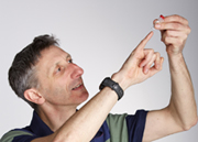 Dr Nick Goldman of EMBL-EBI, looking at synthesized DNA in a phial (Credit: EMBL Photolab)
