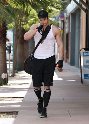 Kellan Lutz would like to show you his biceps.