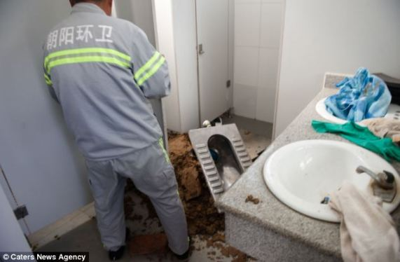 Chinese woman gives birth in public restroom only to watch in horror as newborn is flushed away...