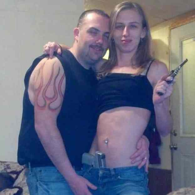 Police chief suspended after photo of him with gun toting woman appears.