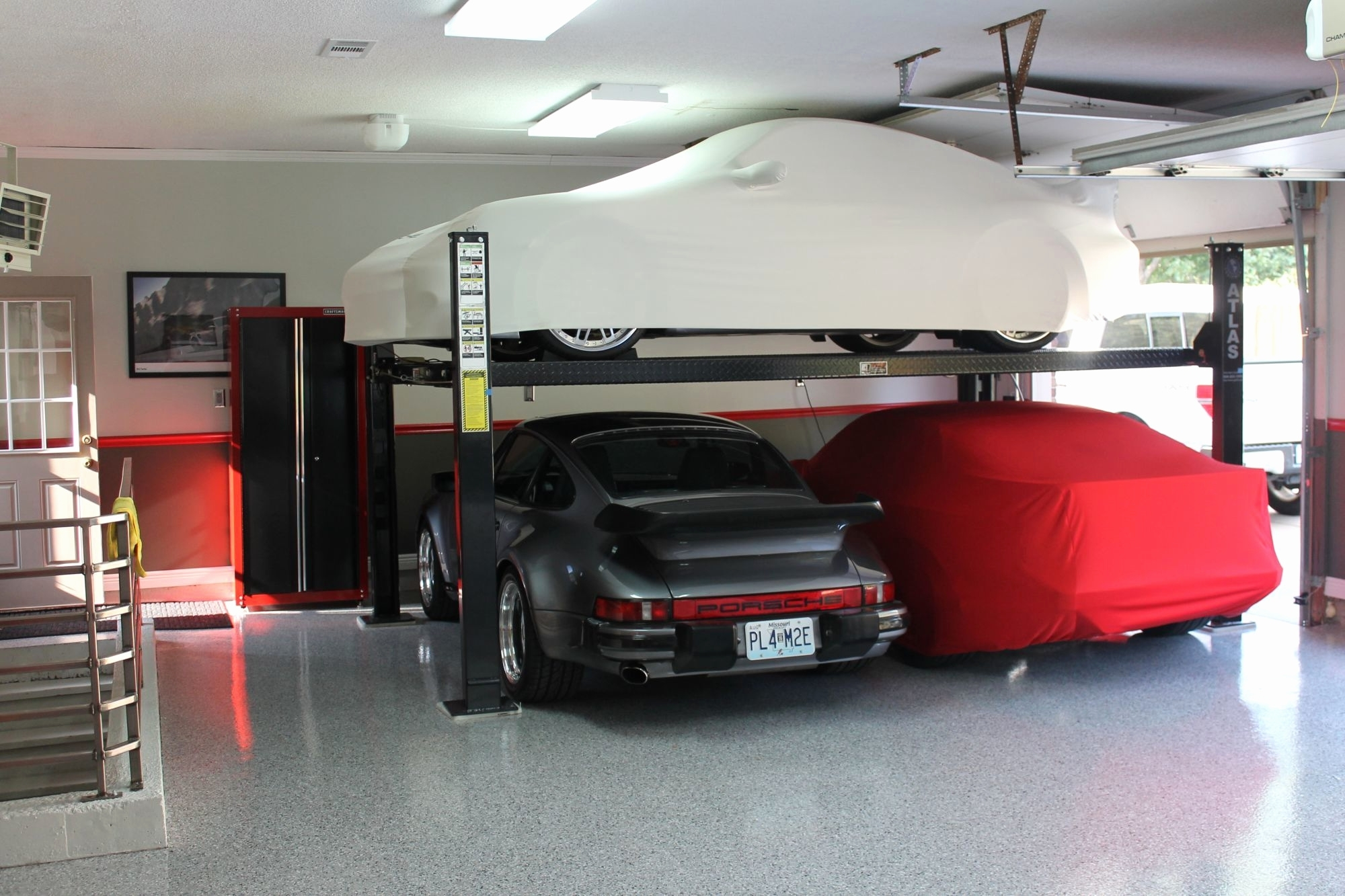 Car Lift In Garage 2 Post Car Lift Home Garage Schmidt Gallery Design