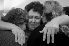 grief-hugging-three