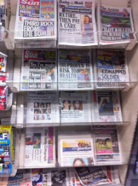 Tabloids on a news stand