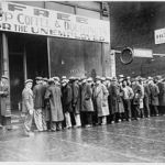 293px-Unemployed_men_queued_outside_a_depression_soup_kitchen_opened_in_Chicago_by_Al_Capone,_02-1931_-_NARA_-_541927
