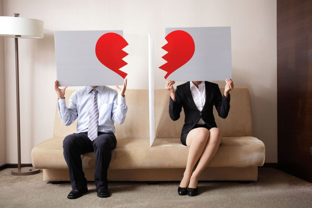 29765997 - divorce - sad young couple holding billboard sign with break love heart, concept for divorce
