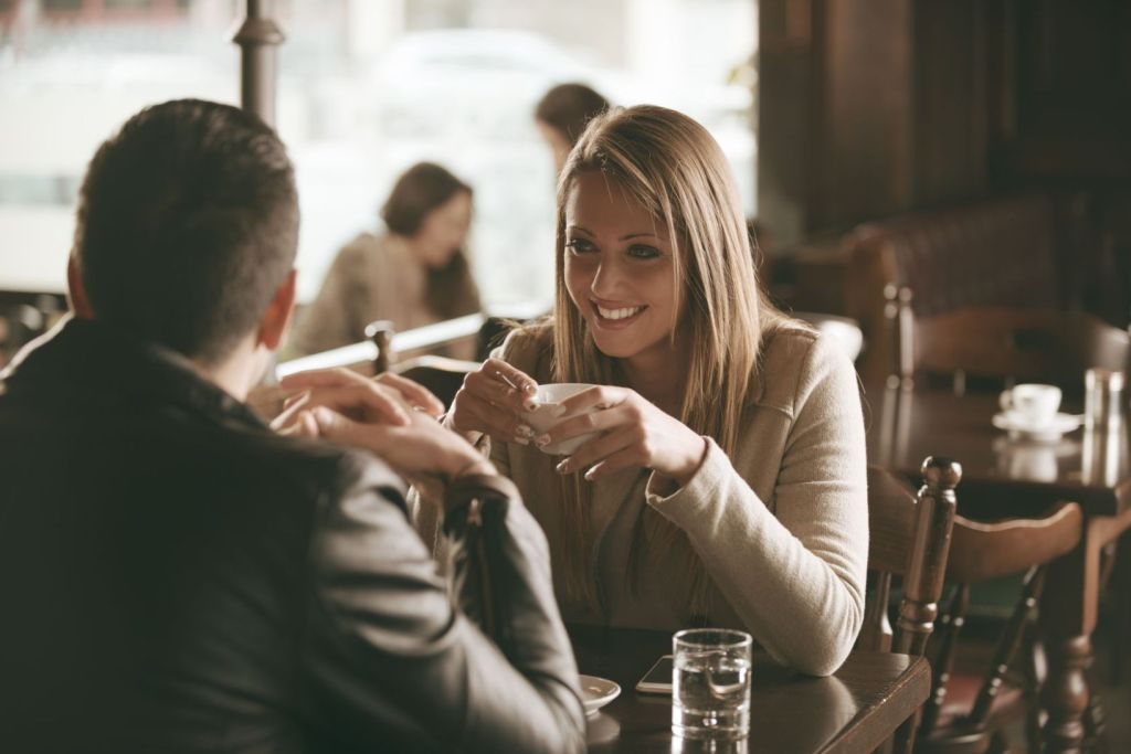 36918315 - young couple at the bar having a coffee and flirting
