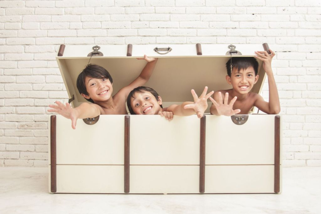 50415451 - portrait of expression of three cheerful brothers inside the crate