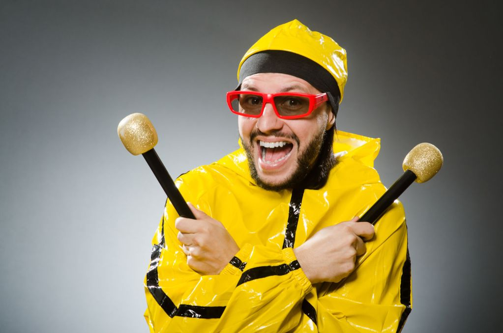 45098983 - man wearing yellow suit with mic